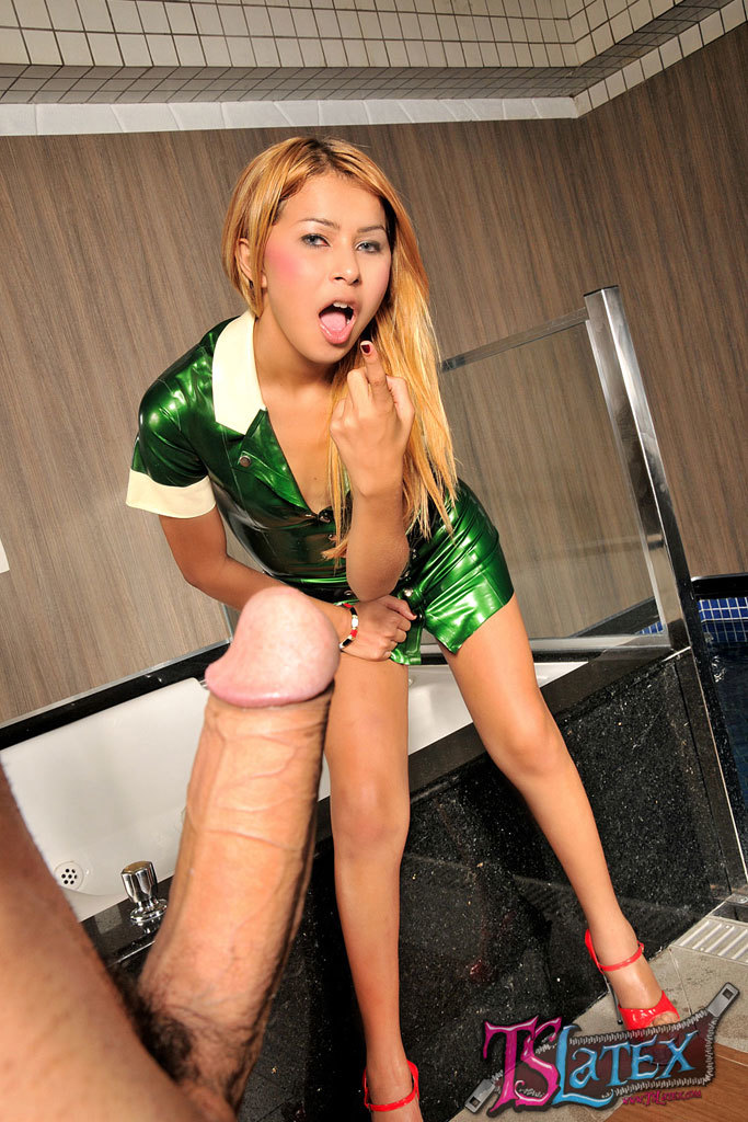 T-Girl In Green Latex Gets Ruined