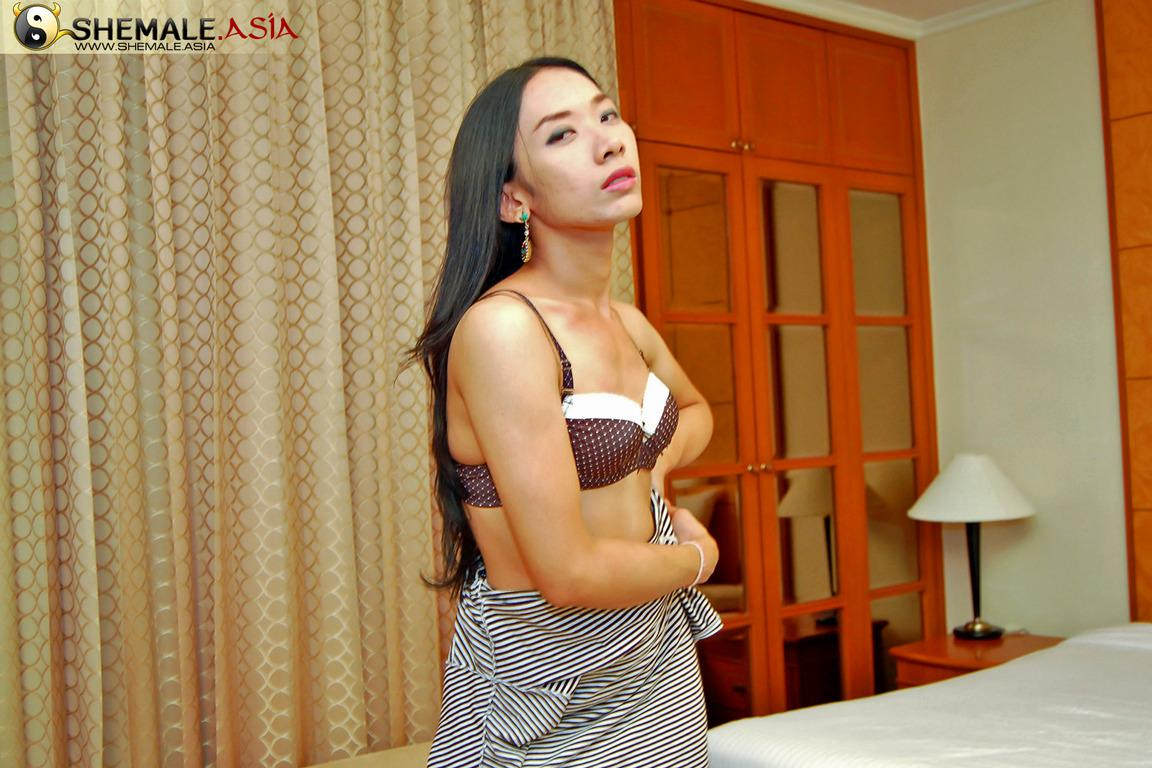Arousing Thai Tgirl Stripping