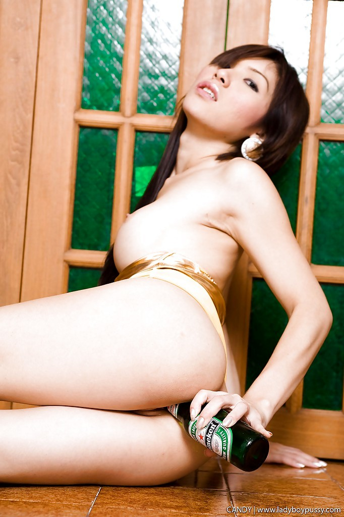 Gorgeous Asian T-Girl Candy Inserts Beer Bottle Into TGirl Pussy