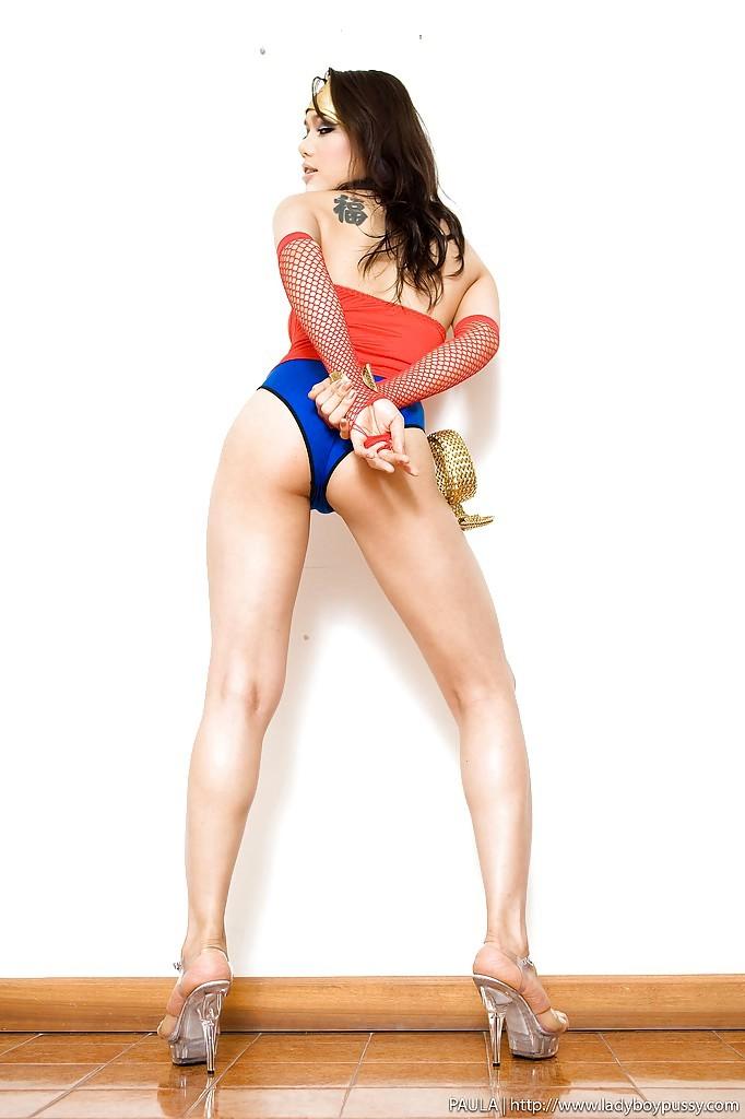 Naughty Thai Ladyboy Paula Wearing A Superhero Costume And Toying Her Pussy