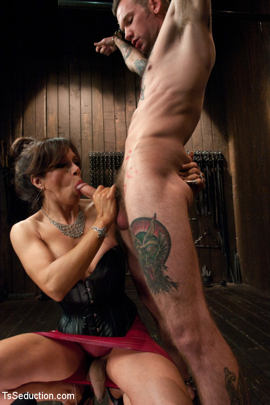 New Dom In Arousing Latex Whips Out Her Dick And Bangs A Bound Slave Boy